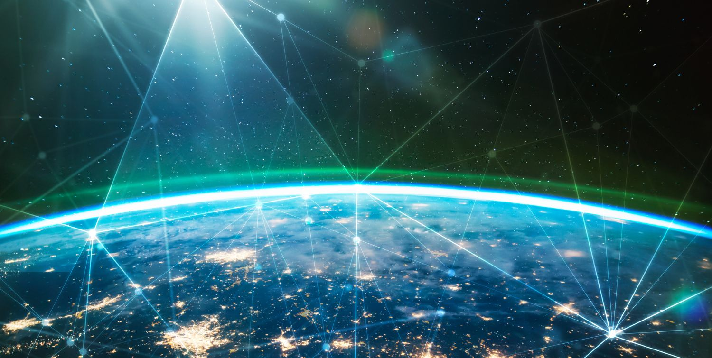 Jordkloden set fra rummet med lysende byer
